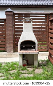Stone garden oven for grill or barbeque is in a backyard at summer season