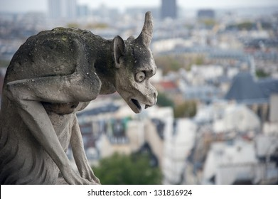Stone gargoyle (Chimera) overlooking the city of Paris from the tower of the Notre Dame