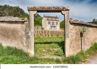 A stone gate leads to a vineyard and a chateau near the outskirts of the town of Gevery Chambertin in the Burgundy region of France.