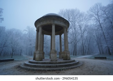 Stone gazebo. Public kiosk in misty park. Gothic atmosphere.