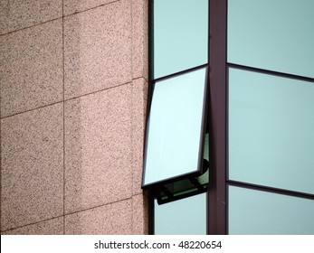 stone and glass office building exterior