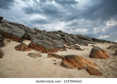 Stone Grave, stones in the sand and beautiful sky, dramatic landscape, nature reserve