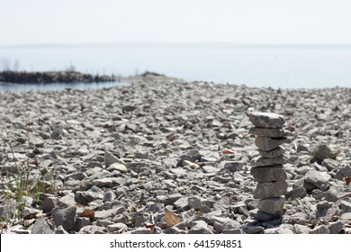the stone gravels stacked on top of each other to make a background. the riprap of crushed stone on the bank of the Volga River.
