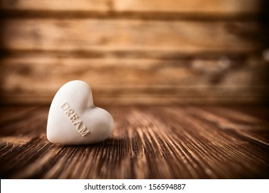 Stone heart on a wooden background.