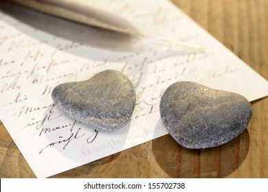 stone hearts with love letter