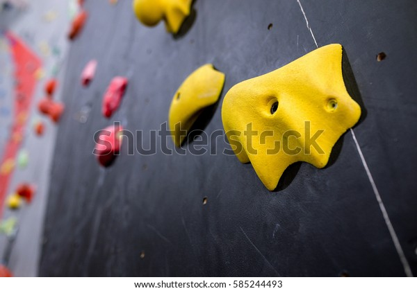 Stone hook on the artificial climbing wall at indoor gym