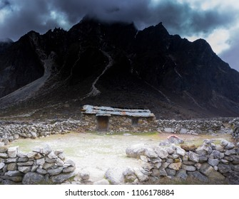 Stone house in front of mountain