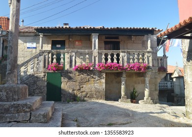 Stone House Full Of Roses Flowers In The Beautiful Village Of Combarrro. Nature, Architecture, History, Street Photography. August 19, 2014. Combarro, Pontevedra, Galicia, Spain.