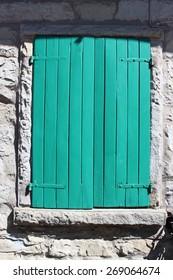 Stone house green wooden window
