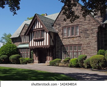 stone house with Tudor style details