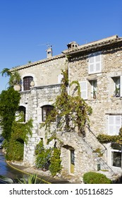 Stone houses decorated with flowers. Famous village of Saint-Paul-de-Vence is a commune in the Alps-Maritimes department in southeastern France - one of the oldest medieval towns on the French Riviera