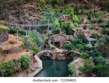Stone houses, suspension bridge