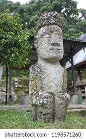 Stone idol in Ambarita village on the Samosir island, Indonesia