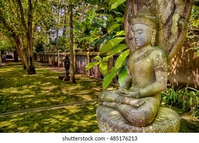 Stone image of meditating Buddha in Mendut temple, Indoensia