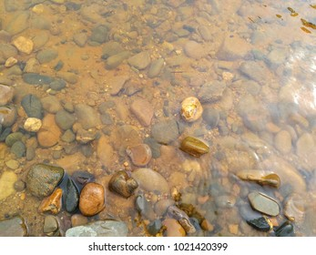 Stone inside a clear water of Lembing River in Kuantan.
