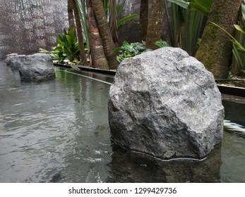 Stone inside the pond