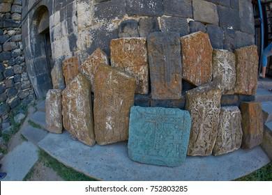 Stone khachkars near famous Sevanavank Monastery at Sevan Lake in Armenia