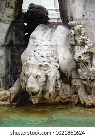 Stone lion drinking from the fountain
