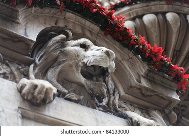 A stone lion during the Christmas season in Lisbon, Portugal.