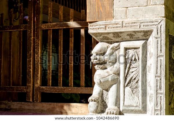 Stone lion in front of the door