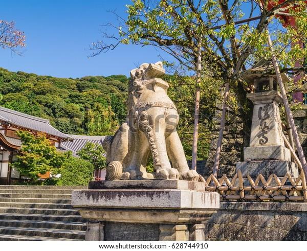 Stone lion sculpture near entrance gate to the ancient Kiyomizu-dera Buddhist temple in Kyoto, Japan