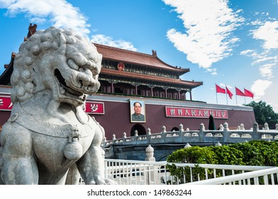A stone lion stands guard at the main gate to the Forbidden City near Tiananmen Square.