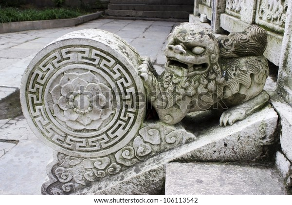 Stone lion statue at a Buddhist temple in Guiyang China