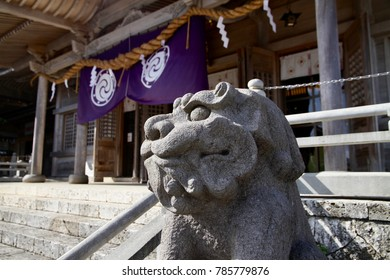 The stone lion statue and the Japanese shrine in Okinawa, Japan.
