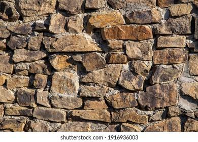 Stone masonry wall texture backgound