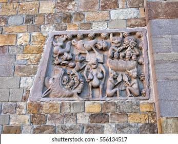 Stone Medieval carving of hell, seven deadly sins, outside church, Fornovo di Taro, Italy. On Via Francigena. Medieval religious art.