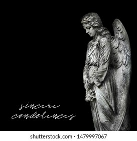 "stone memorial grieving angel statue on black background. condolence, mourning cards or obituary. inscription ""sincere condolences"". conceptual image for design."