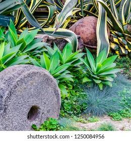 Stone millstone in the garden of Lima