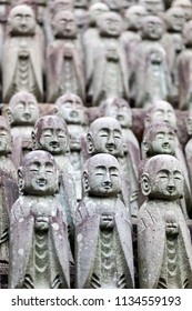 Stone monk statues background in a Buddhist temple in Kamakura, Japan
