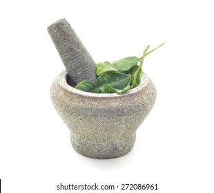 stone mortar and pestle with kaffir lime leaves