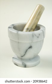 Stone mortar and pestle on white.
