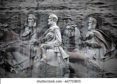 STONE MOUNTAIN, GA - JUNE 24: A closeup of the rock relief carving on Stone Mountain in Stone Mountain, Georgia on June 19, 2017. The large bas-relief carving depicts 3 figures of the Confederacy.