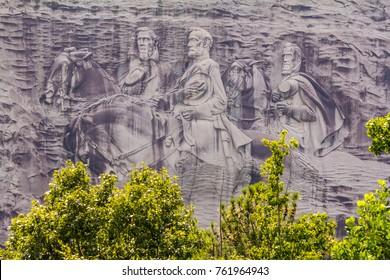 STONE MOUNTAIN, GA - SEPT 25, 2017: Sculpture of Robert E. Lee; Stonewall Jackson and Jefferson Davis on Stone Mountain -- originating site of KKK.