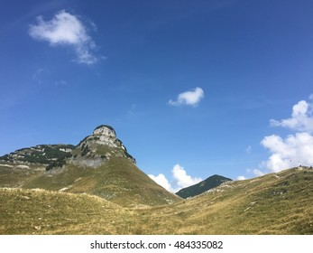 The stone mountains and blue sky.