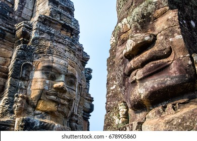 Stone murals and statue Bayon Temple Angkor Thom. Angkor Wat the largest religious monument in the world. Ancient Khmer architecture.  Location: Siem Reap, Cambodia