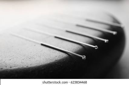 Stone and needles for acupuncture, closeup