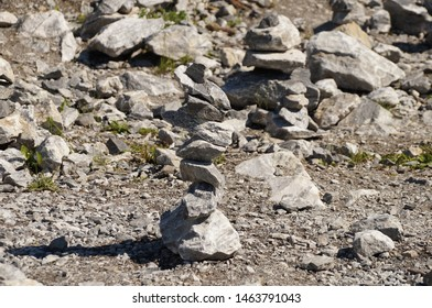 Stone on stone. Balancing stones on each other of various shapes and sizes. Granite on the background of cobblestones. Concept: searching for the center of gravity, patience and skill