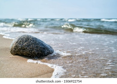 Stone on the beach of the Baltic coast at Rewal in Poland