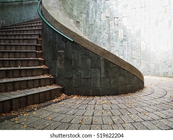stone outdoor spiral staircase at fort canning park in Singapore