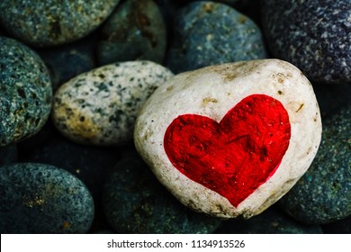 Stone painting - Red Heart on white stone.