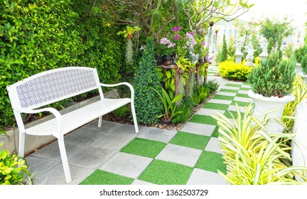 Beautiful garden and stone path with green grass and chair ,outdoor .