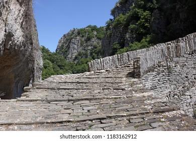 stone path kokkori bridge Zagoria Greece