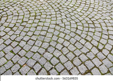Stone path at the old town in Europe. Texture, close up.