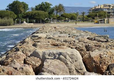 A stone path on the sea. Spain