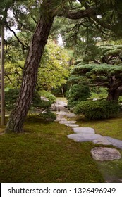 Stone path in traditional japanese garden in former Kyoto Imperial Palace, Japan
