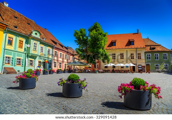 Stone paved old street with cafe bar in city center,Sighisoara fortress,Transylvania,Romania,Europe